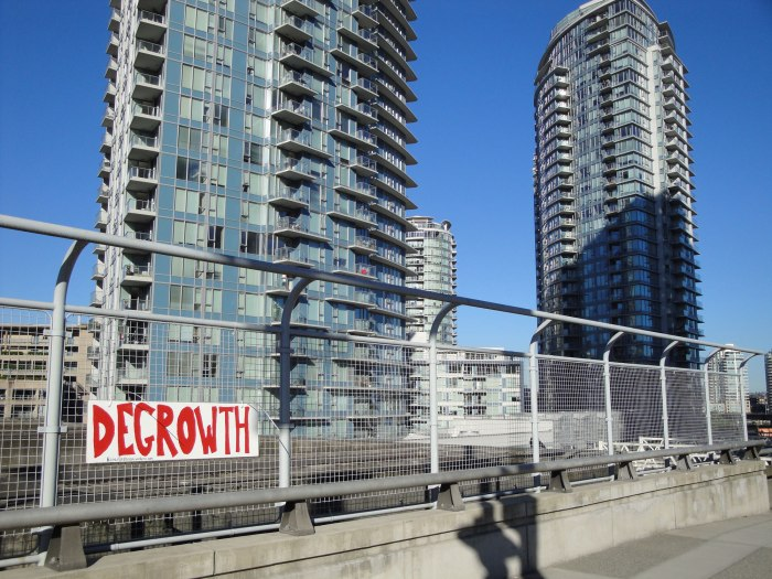 Degrowth sign on Dunsmuir Viaduct, Vancouver (Canada). Source: ecocollectivism.wordpress.com