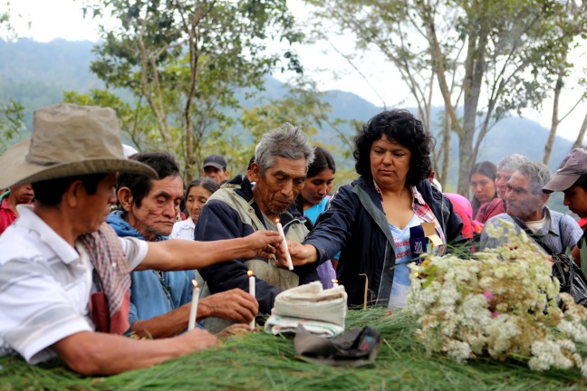Berta Caceres in the Rio Blanco region of western Honduras where she, COPINH (the Council of Popular and Indigenous Organizations of Honduras) and the people of Rio Blanco have maintained a two year struggle to halt construction on the Agua Zarca Hydroelectric project, that poses grave threats to local environment, river and indigenous Lenca people from the region. She gathered with members of COPINH and Rio Blanco during a meeting remembering community members killed during the two year struggle.