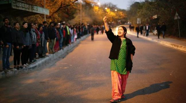 A student shouts slogans even as JNU teachers and students form a human chain inside the campus in protest against arrest of JNUSU President Kanhaiya Kumar on Sunday. Express photo by Oinam Anand. 14 February 2016