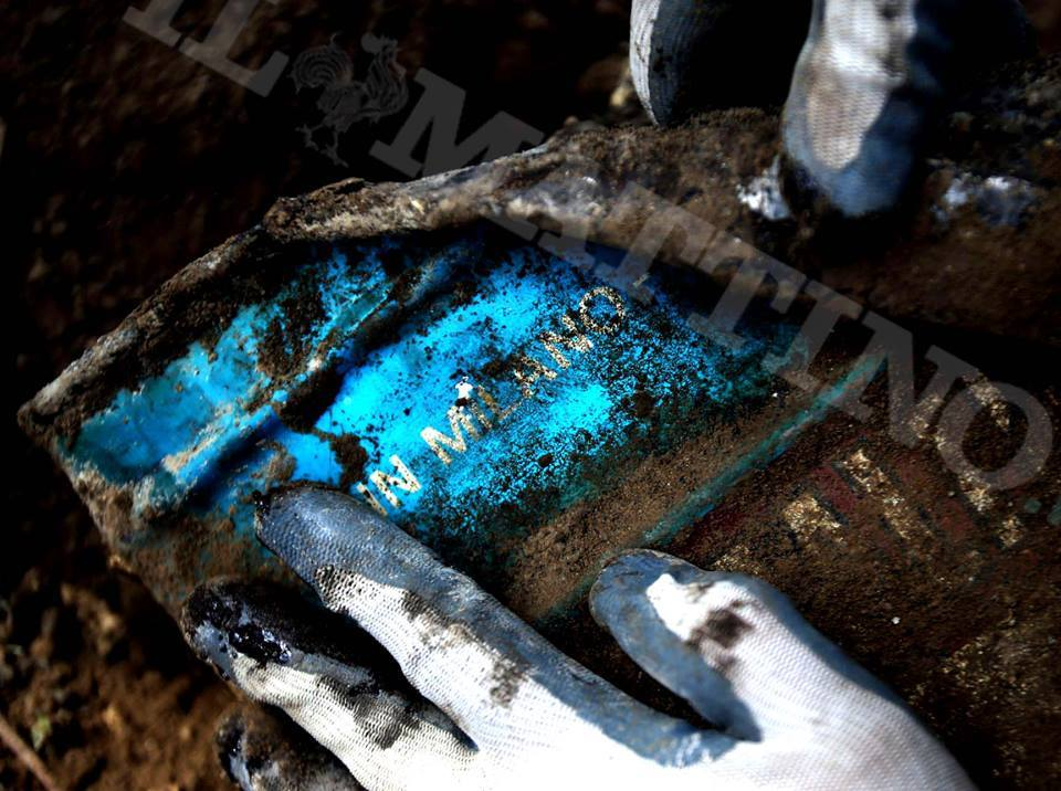 "A special unit of Italian firefighters analyse an illegal waste dump uncovered under cultivated fields in Caivano, near Naples, on September 2013. In the photo it is possible to read the label of one of the barrels unearthed from the illegal dump: it says ""Milano"", an industrial centre in Northern Italy. (Source: Corriere della Sera)."