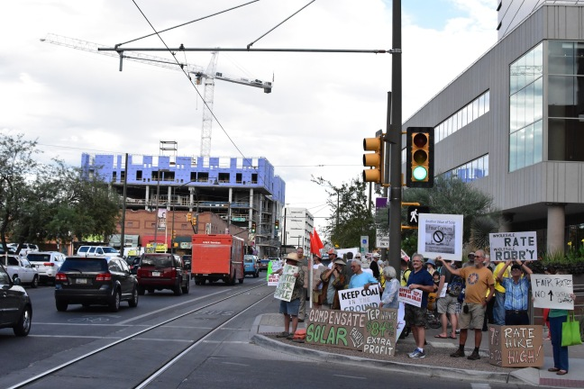 Tucson residents gather at a rally outside the utility's headquarters, calling for fair rates that incentivize solar. Author: Remy Franklin.